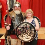 Wir Jarl presenting the shield to Alexis a Committee Member for the Hall